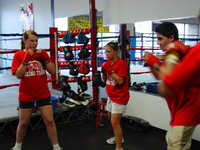 Boxing students working on stance